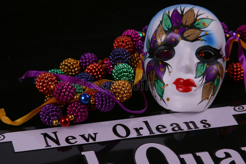 New Orleans Mask and Beads. Mardi Gras mask and beads with New Orleans on a sign with black background stock photo