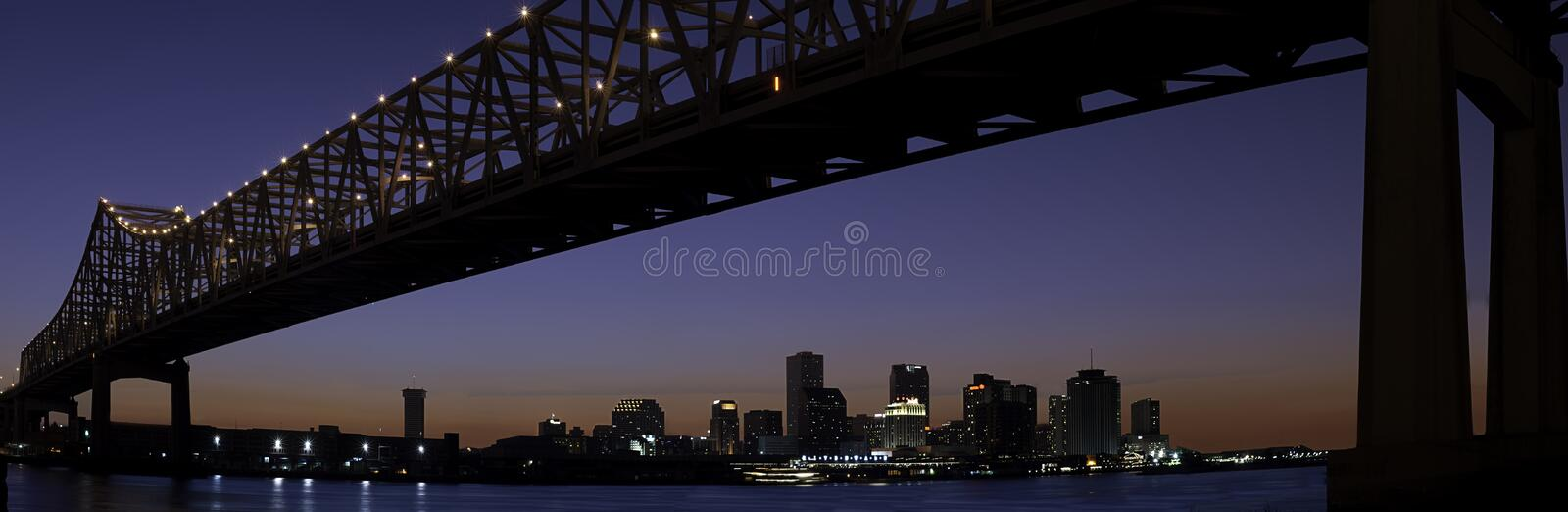 New Orleans Skyline and Mississippi River Bridge royalty free stock images