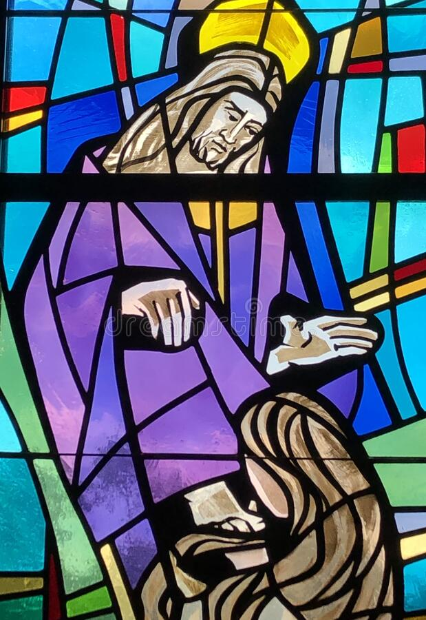 Mary Magdalene washes Jesus' feet. NEW ORLEANS, UNITED STATES - Jul 16, 2019: Stained Glass image of Mary Magdalene washing Jesus' feet. Taken at royalty free stock photos