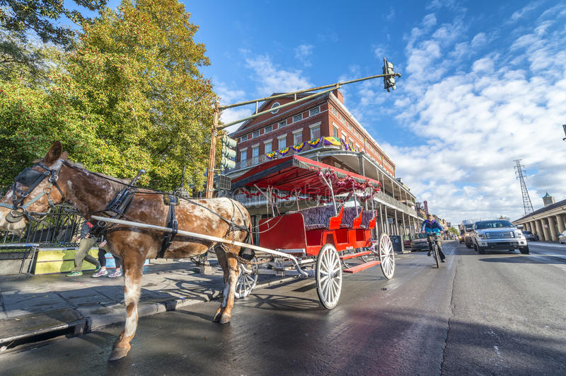 NEW ORLEANS, USA - FEBRUARY 2016: Red horse carriage along Jacks stock photos