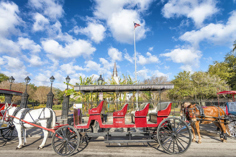 NEW ORLEANS, USA - FEBRUARY 2016: Red horse carriage along Jacks royalty free stock image