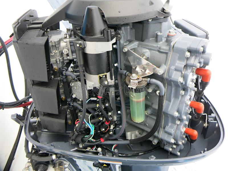 New outboard engine Yamaha 200 HP. New Yamaha 200 HP outboard boat, two-stroke. Open lid - view royalty free stock photo