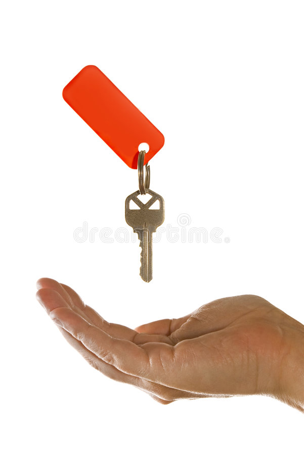 New Owner. Hand accepting a key isolated on white background royalty free stock images