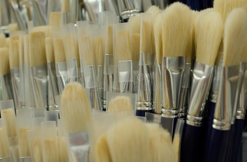 New paint brushes in the store. background royalty free stock photo