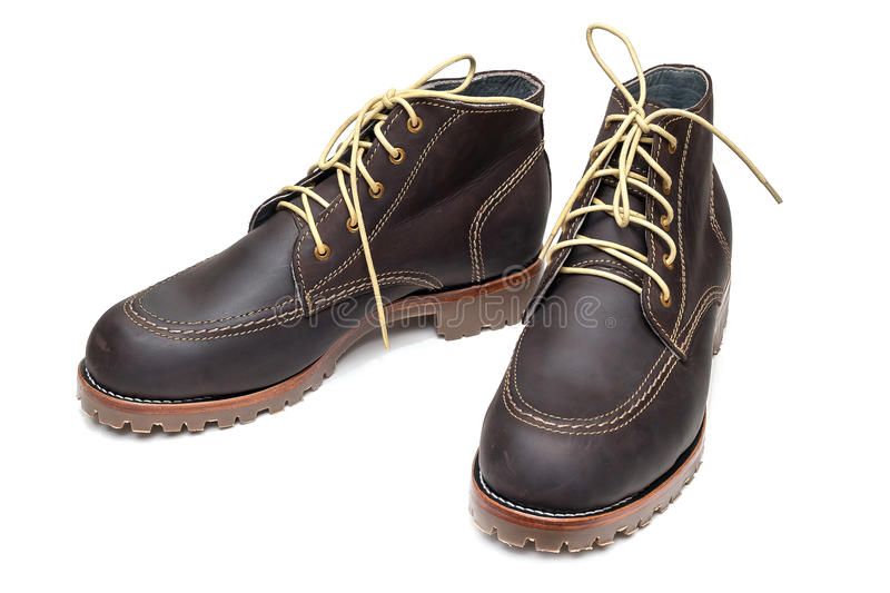 New pair of dark brown color full grain nubuck leather boots wit royalty free stock images
