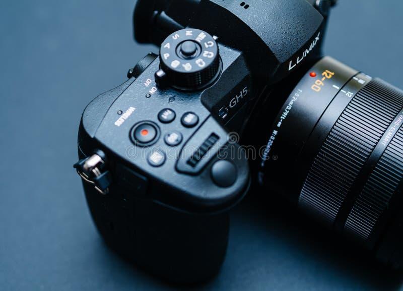 New Panasonic Lumix GH5 and Leica 12-60 camera lens. PARIS, FRANCE - APR 9, 2017: Button details of the new Panasonic Lumix DMC-GH5 - and Leica Vario-Elmarit 12 stock images