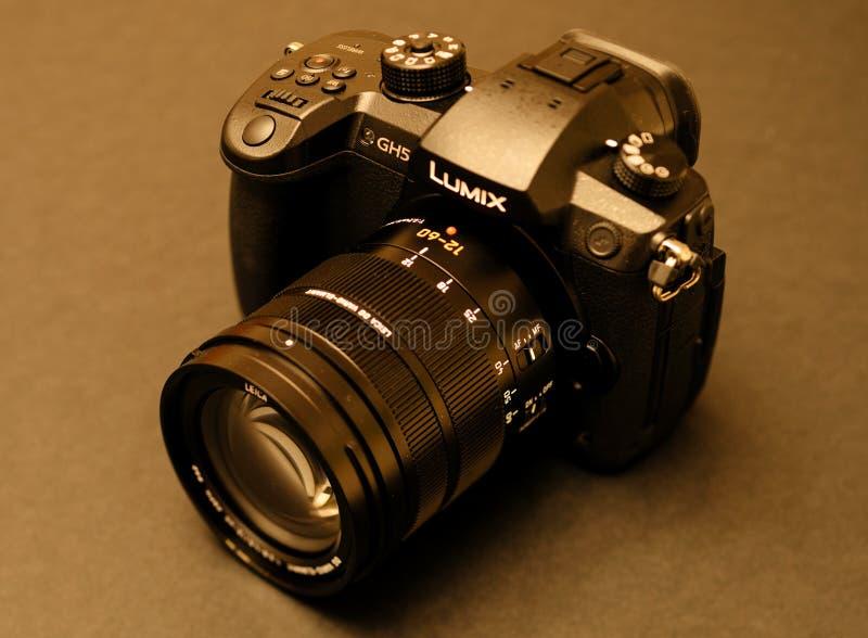New Panasonic Lumix GH5 and Leica 12-60 camera lens. PARIS, FRANCE - APR 9, 2017: Sepia view detail of the Panasonic Lumix DMC-GH5 - and Leica Vario-Elmarit 12 stock photography