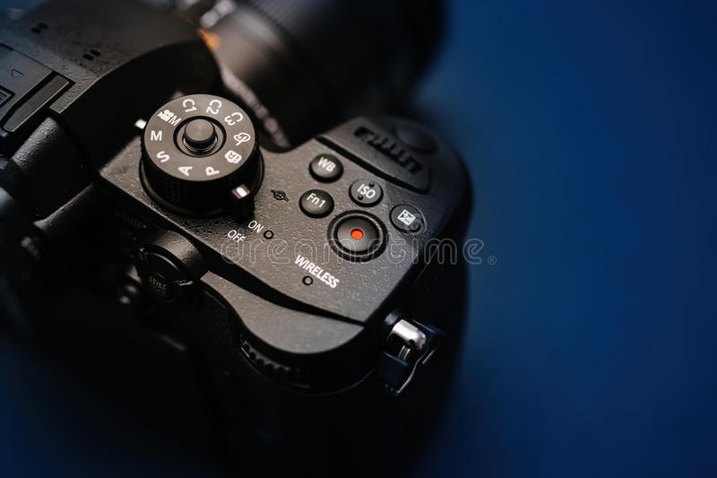 New Panasonic Lumix GH5 and Leica 12-60 camera lens. PARIS, FRANCE - APR 9, 2017: View from above of the the Panasonic Lumix DMC-GH5 - and Leica Vario-Elmarit 12 royalty free stock photography