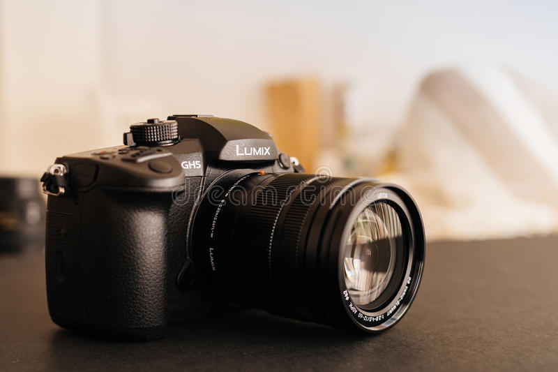 New Panasonic Lumix GH5 and Leica 12-60 camera lens. PARIS, FRANCE - APR 9, 2017: view detail of the Panasonic Lumix DMC-GH5 - and Leica Vario-Elmarit 12-60 stock photos