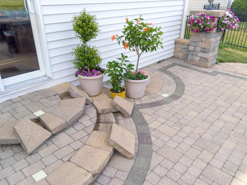 New paving bricks laid out on curved patio steps stock photo
