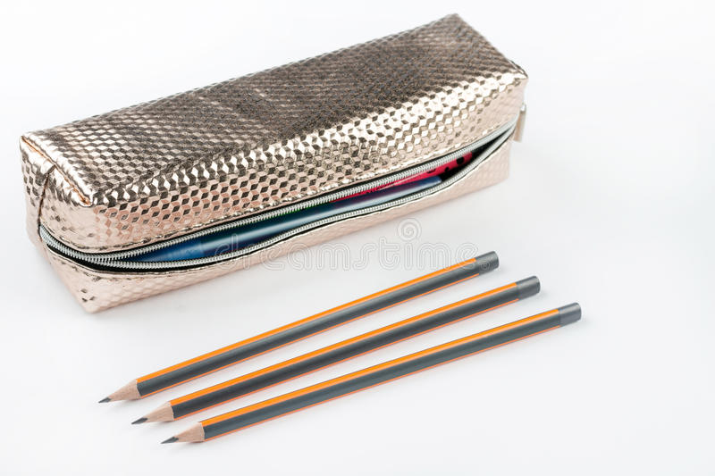 New pencil case with wooden pencils isolated above white backgro. Und royalty free stock photography