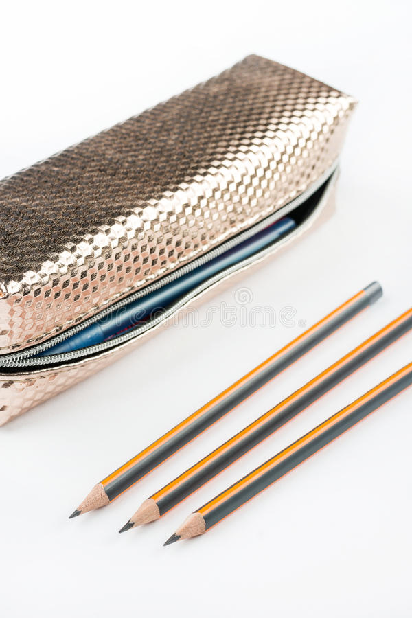 New pencil case with wooden pencils isolated above white backgro. Und royalty free stock photos