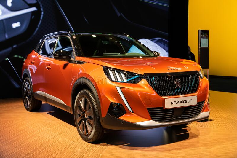 New Peugeot 2008 GT car. BRUSSELS - JAN 9, 2020: New Peugeot 2008 GT car model presented at the Brussels Autosalon 2020 Motor Show orange suv modern automobile stock image