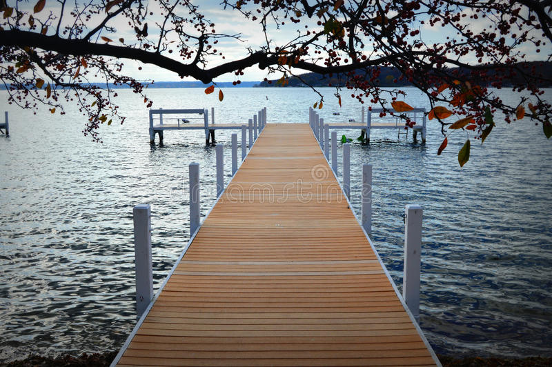 New Pier on Lake. A brand new pier on Lake Geneva, Wisconsin in Walworth County stock images