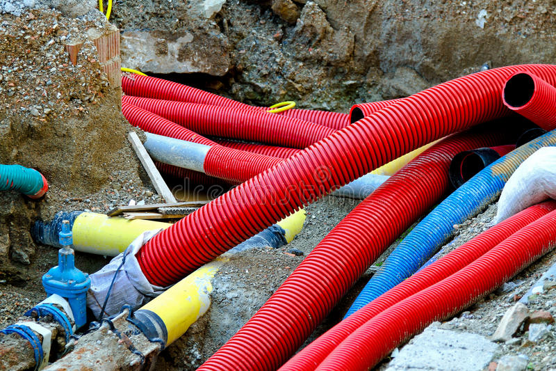 New pipes. Underground construction of pipes hoses and cables stock photo