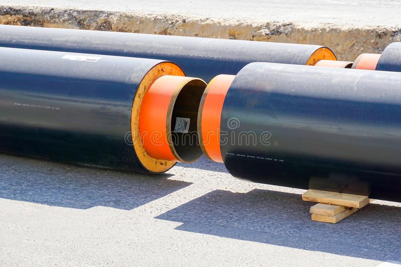 New piping with thermal insulation. Replacement of the pipeline in the city of Volgograd royalty free stock images