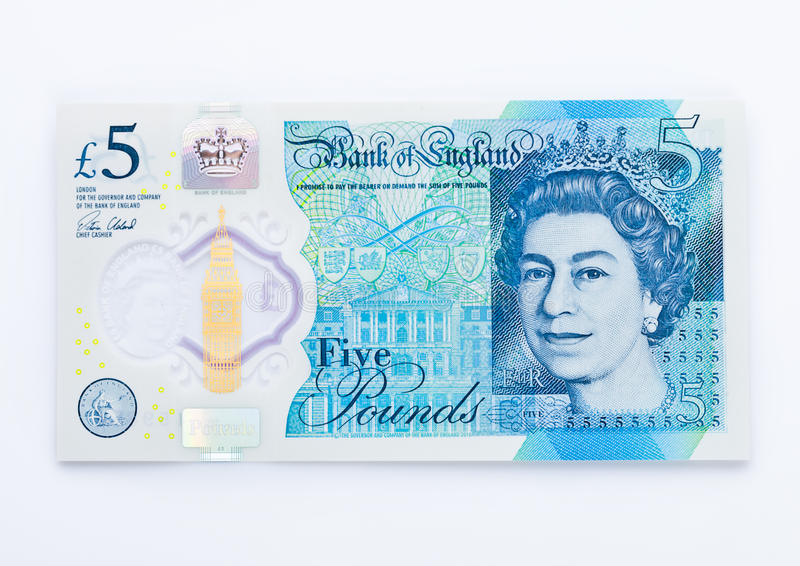 New plastic five pound note british money on white royalty free stock image