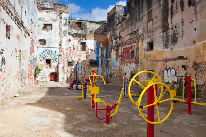 New playground in the courtyard between the old colonial houses. stock images