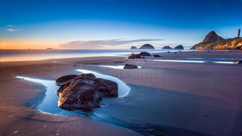 New Plymouth, New Zealand. Just a very little piece of what is the beauty of New Zealand. This beach is scattered with boulders and it is simply stunning to royalty free stock photo