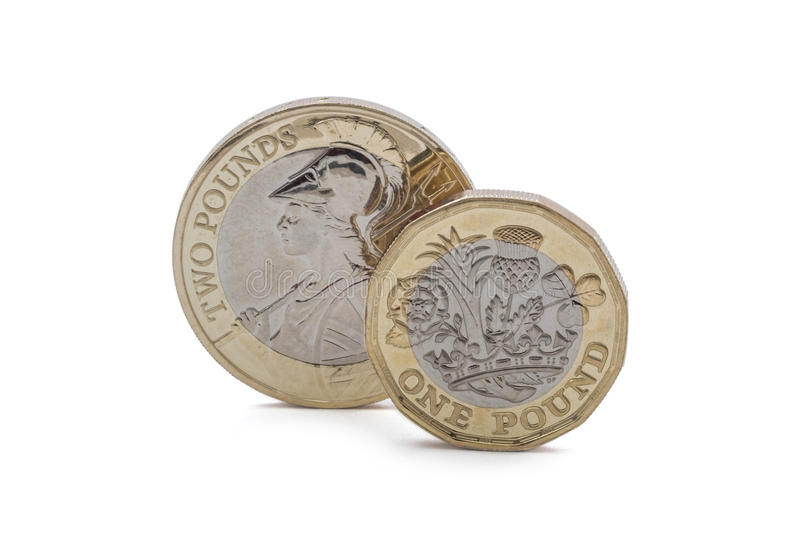 British money, coin and two pound coin. New designs of british money, the new shape of the pound coin to be introduced in 2017 royalty free stock photography