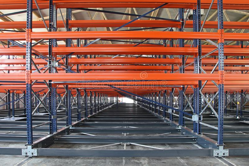New Warehouse Shelves. New Powered Mobile Shelves in Distribution Warehouse royalty free stock image