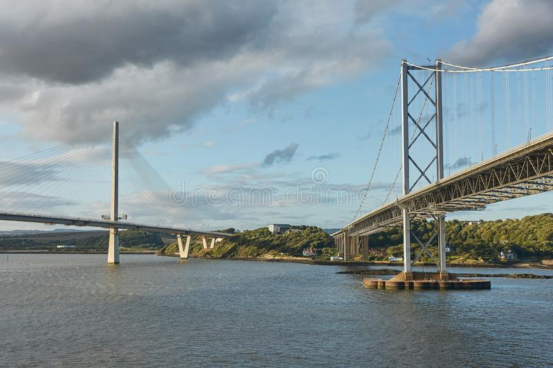 The new Queensferry Crossing bridge over the Firth of Forth with the older Forth Road bridge in Edinburgh Scotland.  stock images