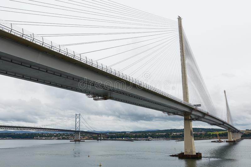 The new Queensferry Crossing bridge over the Firth of Forth with the older Forth Road bridge in Edinburgh Scotland.  stock image
