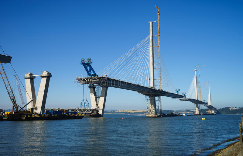 The new Queensferry Crossing Bridge under construction, seen from Port Edgar Edinburgh, Scotland. Showing the mobile cranes used for lifting new sections of stock photo