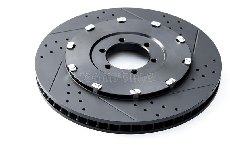 NEW Racing car brake disc - Black ventilated brake discs on a white background. The rotor is the rotating part of a wheel`s disc b stock photos