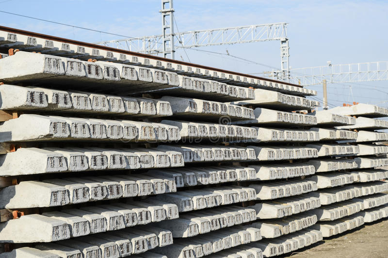 New rails and sleepers. The rails and sleepers are stacked on each other. Renovation of the railway. Rail road for the train.  stock image