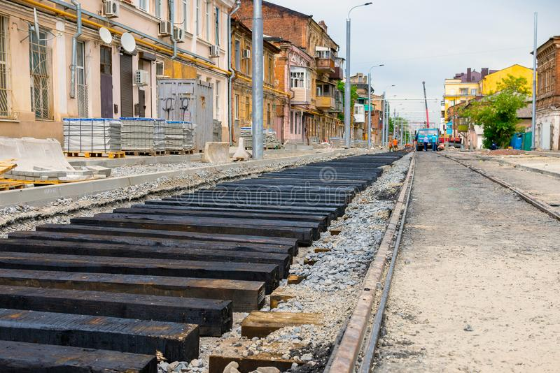 New rails and wooden sleepers are prepared for laying on gravel royalty free stock images
