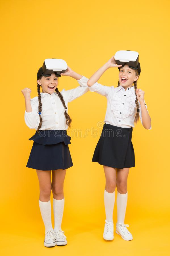 New reality is here. Digital future and innovation. virtual reality. small girls in VR headset. future education. back. To school. children wear wireless VR stock images