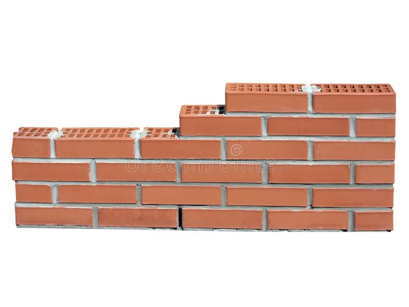 New red brick wall in construction process on white stock photo
