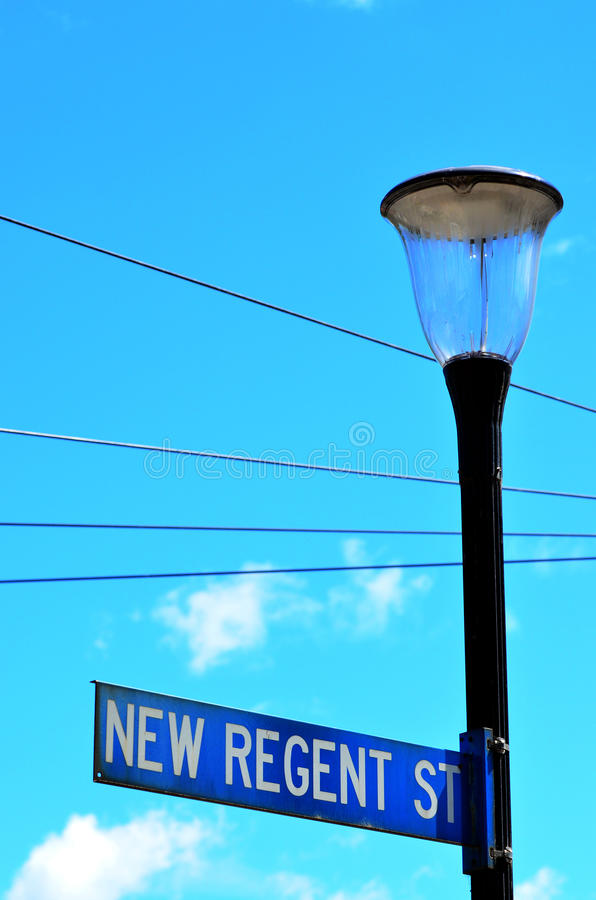New Regent Street in Christchurch - New Zealand. CHRISTCHURCH - DEC 08 2015:Street signpost of New Regent Street. Christchurch's beloved New Regent Street is royalty free stock photo