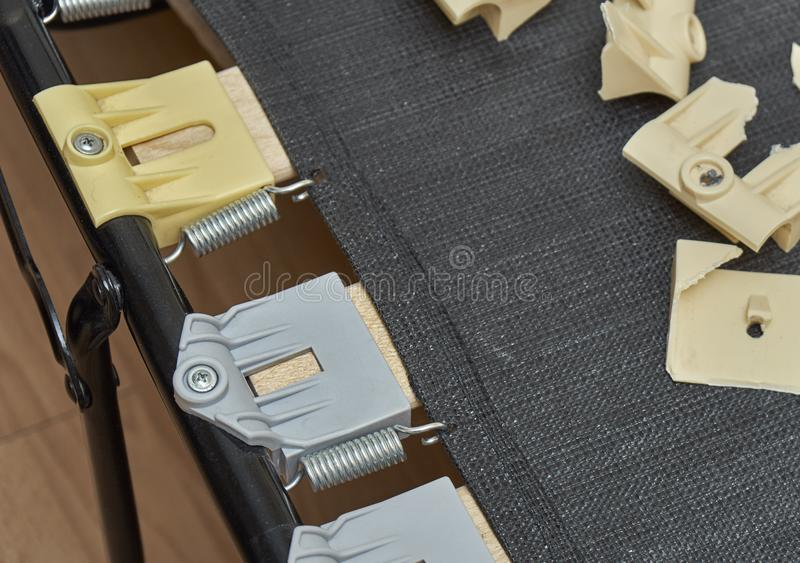 New replaced plastic bed slat holders and old broken ones. New just replaced plastic bed slat holders and old broken ones lying on bed royalty free stock photography
