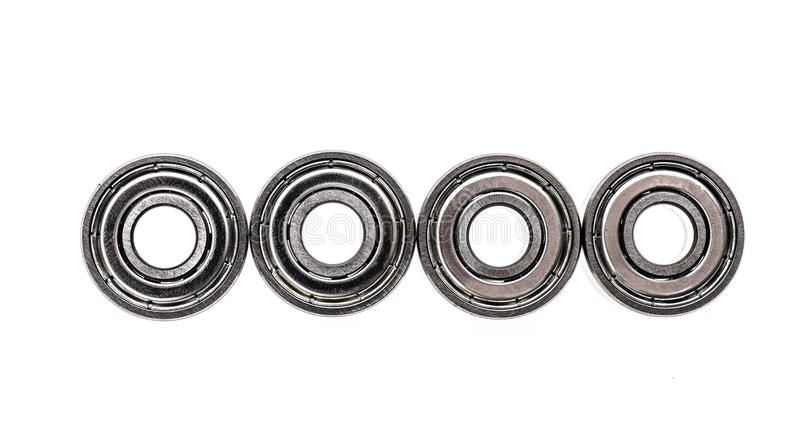 New replacement Roller Skate Bearings isolated on white background. Standard ABEC7 type bearings for inline skates, skateboards or scooters royalty free stock photo