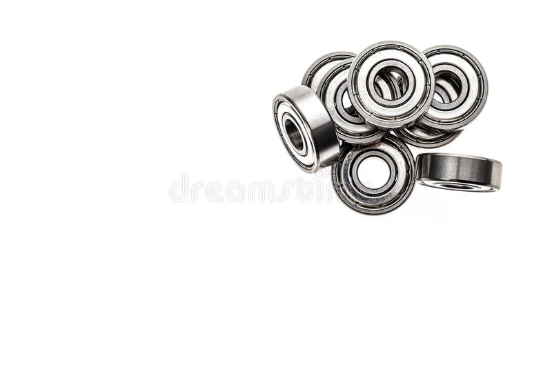 New replacement Roller Skate Bearings isolated on white background. Standard ABEC7 type bearings for inline skates, skateboards or scooters stock photos