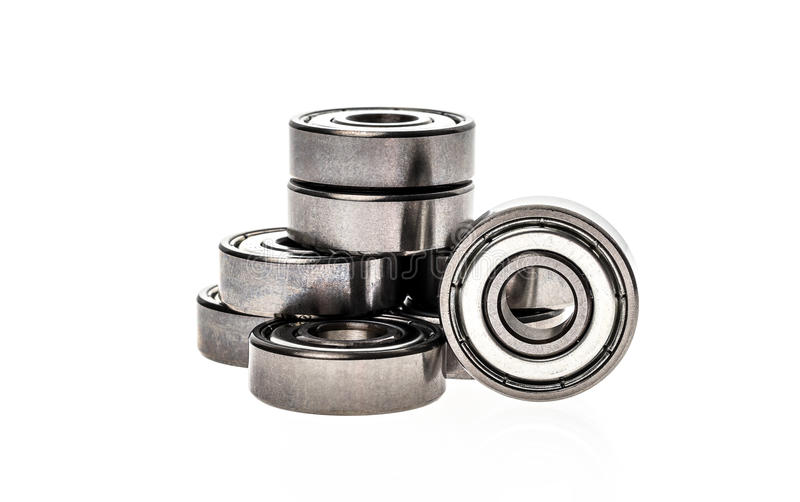 New replacement Roller Skate Bearings isolated on white background. Standard ABEC7 type bearings for inline skates, skateboards or scooters royalty free stock photography