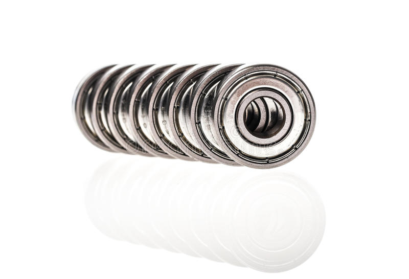 New replacement Roller Skate Bearings isolated on white background. Standard ABEC7 type bearings for inline skates, skateboards or scooters stock photography