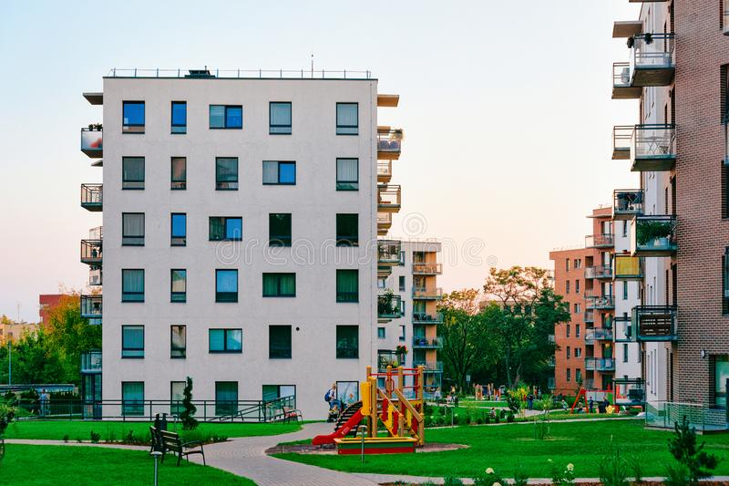 New residential apartment building exterior children playground. Vilnius, Lithuania - September 20, 2018: Modern new residential apartment building exterior stock images