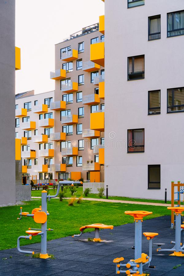 New residential apartment flat house building and gym fitness playground. With outdoor facilities concept stock images