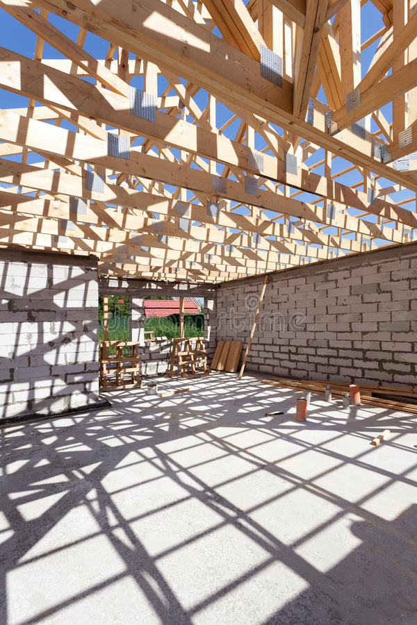 New residential wooden construction home framing. Building a roof with wooden balks. royalty free stock image