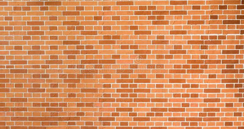 New restored red-orange and brown decorative brick wall. stock images
