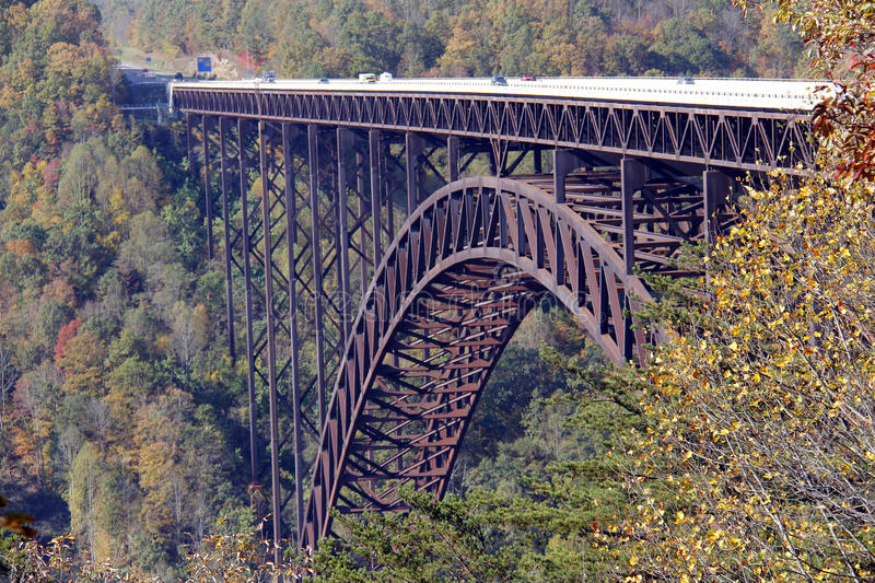 New River Gorge Bridge. A view from the top of the New River Gorge Bridge, West Virginia. Angle view with cars visible traveling on top royalty free stock photography
