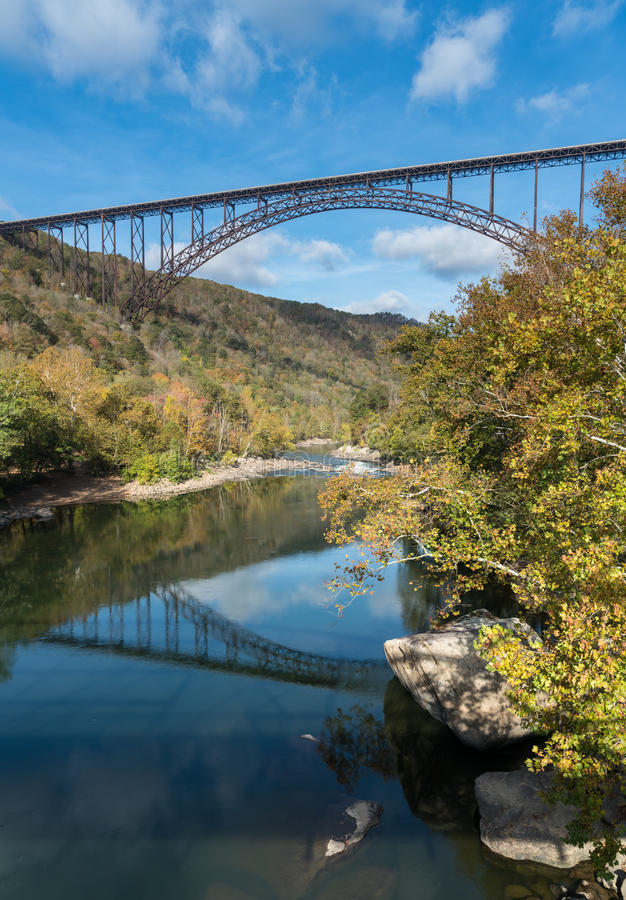 New River Gorge Bridge in West Virginia. Reflections in the calm water under the high arched New River Gorge bridge in West Virginia royalty free stock images