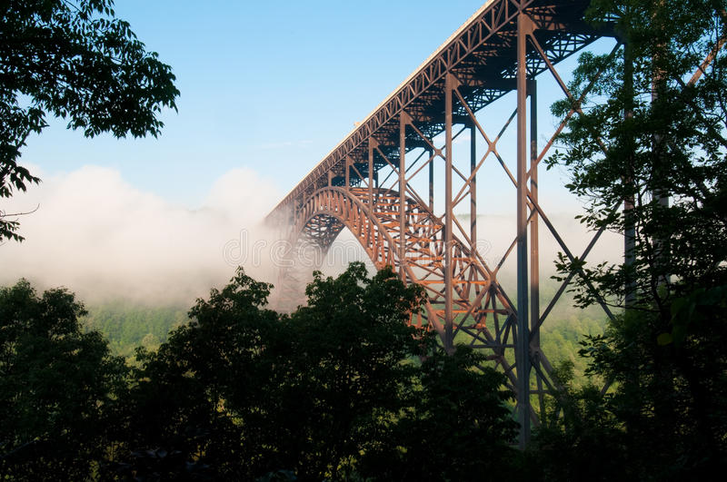 New River Gorge Bridge1. Beautiful sunrise view of fog rolling in at the New River Gorge Bridge. The largest Arch Bridge in the Western Hemisphere stock photos