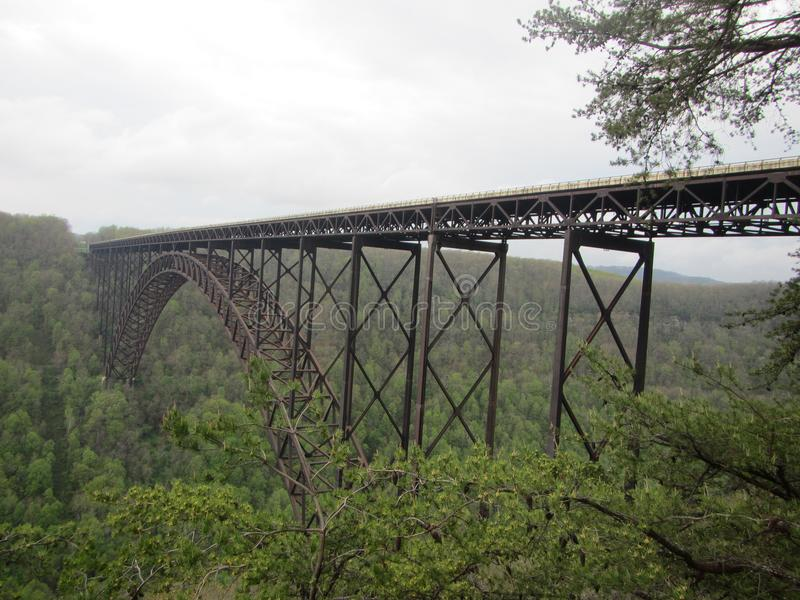 New River Gorge Steel Bridge. Steel construction bridge over new river gorge fayetteville west viriginia apalachian mountains. Geometric shapes formed from royalty free stock photography