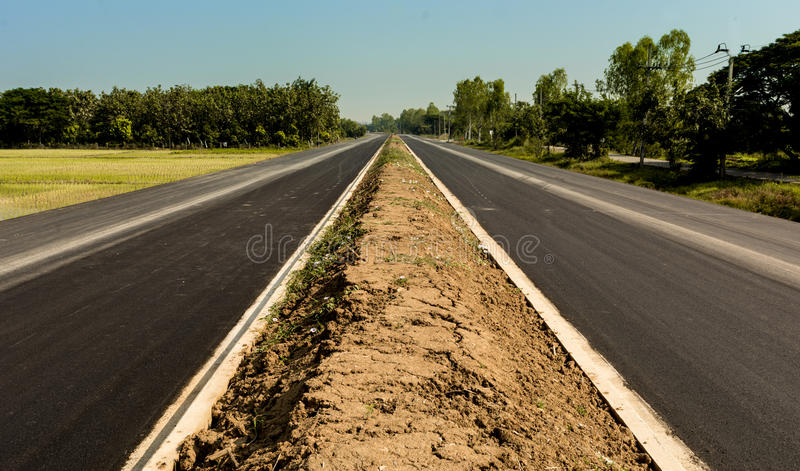 New road. The brand new road just finish wiyh new top asphalt stock photography