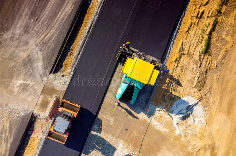 New road construction. Aerial view on the new asphalt road under construction stock photo