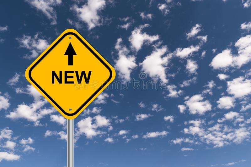 New road sign. With arrow against blue cloudy sky stock photography